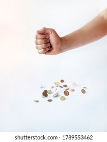 various kinds ov coins on the hand on the white background