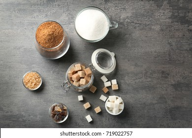 Various kinds of sugar on grey table