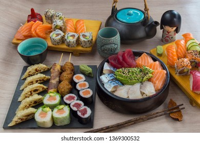 Various kinds of sushi served on wood table. Sushi menu for Japanese food