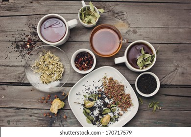 Various kinds of tea on wooden table