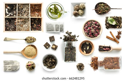 Various kinds of tea, spoons and rustic dishware, brewed green tea, cinnamon, topview