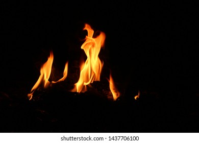 Various kinds of yellow-red flames that are swaying at night