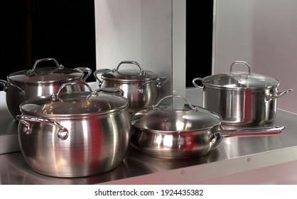 various kitchen utensils on table, in the kitchen