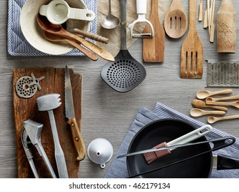 various kitchen utensils on wooden table, top view
