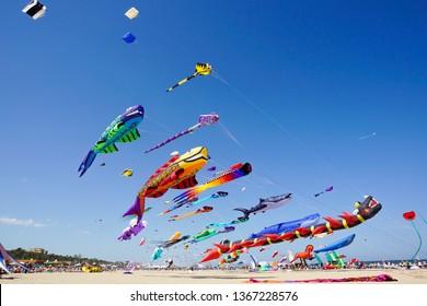 Various kites flying on the blue sky in the kite festival