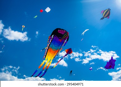 Various kites flying on the blue sky in the kite festival