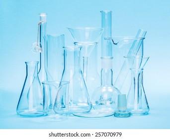 Various laboratory glassware on blue background
