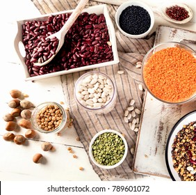 Various legumes on white wooden background. Top view