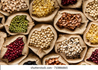 Various of legumes in sack bag, top view