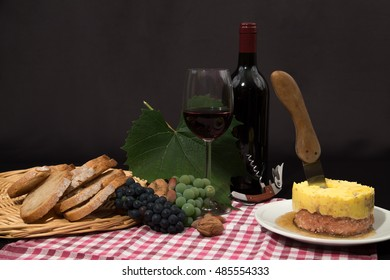 "various of local specialty goat ""foie gras"", fruits and wine in front of black background"