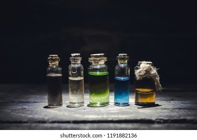 Various magic potions or colorful essential oils in the bottles on the table.