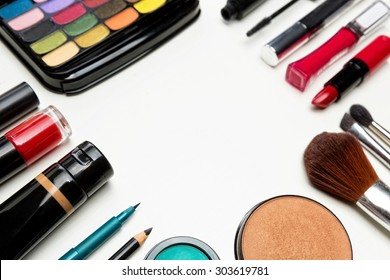 Various make up items, set around copy space for text.