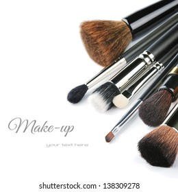Various makeup brushes isolated over white