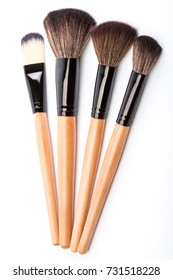 Various makeup brushes isolated over white. wooden makeup brushes. Duo fibre foundation makeup brush. Style. Fashion. Visage. Cosmetics.
