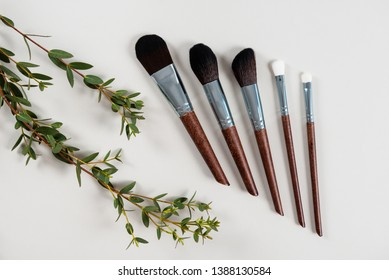 Various makeup brushes on grey background. Style. Fashion. Visage. Cosmetics Top view