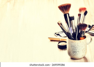 Various makeup brushes on light background with copyspace - Shutterstock ID 269599286