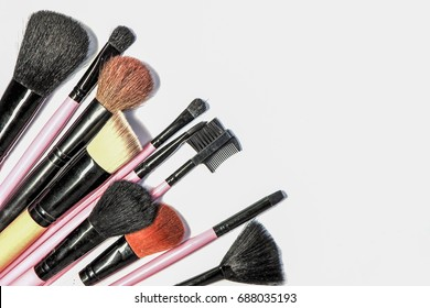 various makeup brushes on white background, diagonal arrangement