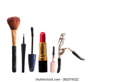 Various makeup products isolated on white background with copyspace