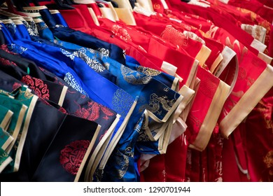 Various and many of Chinese cloth cheongsam selling at street market before Chinese New Year Day.