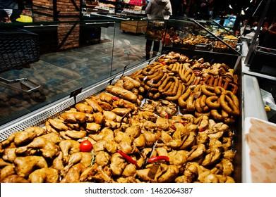 Various meat on supermarket shelves for sale.