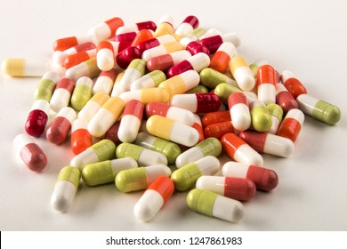 various medical capsules on a bright background
