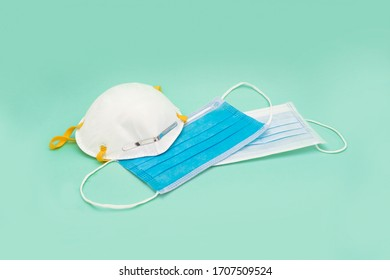 Various medical face mask on color background