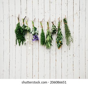 Various medicinal herbs are dried on wooden wall