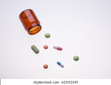 various medicine drugs with pill jar on lab light table, photo