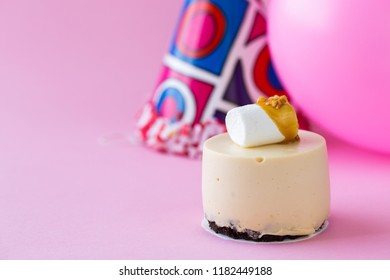 Various mini cakes on color background. Sweets decorated with fresh berries for holiday.