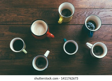 various mugs of coffee, wooden table, top view