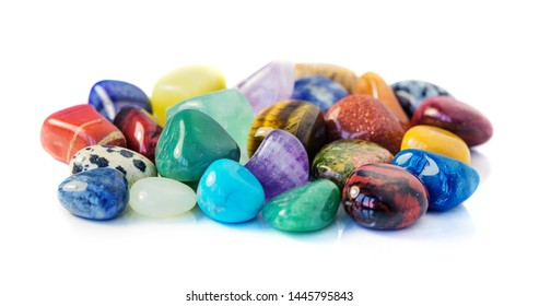 Lot of various multicolored gems isolated on white background