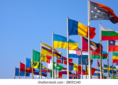 Various national flags on blue sky