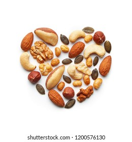 Various nuts arranged in a heart shape. Almond, peanut, brazil nut, pumpkin seed, sunflower seed, cashew, hazelnut, walnut assortment. Healthy lifestyle concept. Top view