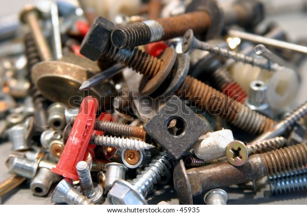 various nuts and bolts and screws and nails and the sorts piled high upon each other