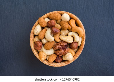 Various nuts on stone background. Concept healthy snack.