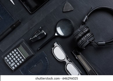 various office supplies with headphones mock-up isolated on black