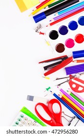 Various office supplies on a white background. Back to school. Top view with copyspace