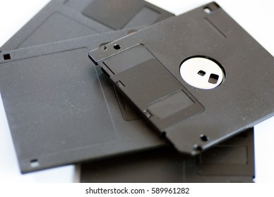 various old obsolete 3 inch floppy disk on white
