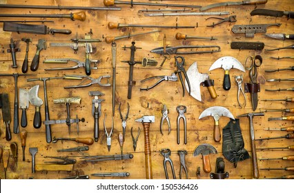 Various old tools on the wall in leather craft workshop