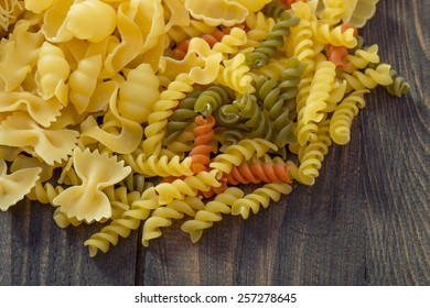 Various pasta on the wooden table.