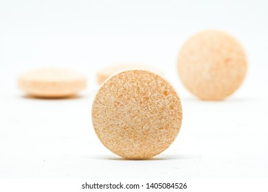 various pills macro on white background.