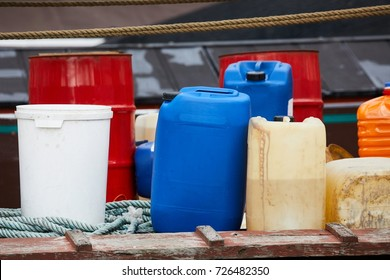 Various plastic cans with chemicals and fuel