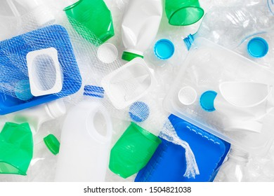 Various plastic waste on the white background, rubbish sorting and utilisation concept