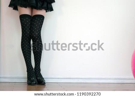 924a22abbf0 Various poses of beautiful legs of black knee high socks on micro miniskirt.