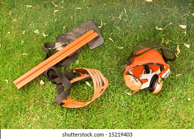 Various protective gear used when cutting hedges or felling trees