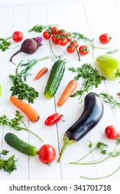 Various raw vegetables on white wood table, selective focus