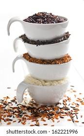 various rice in white ceramic bowls