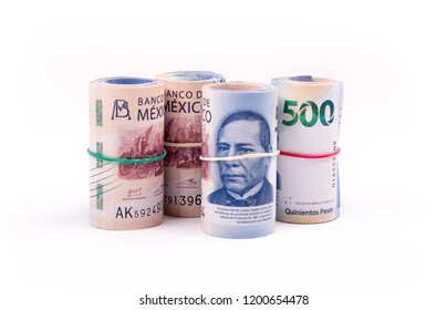various rolls of banknotes, lined up to form the original banknote on white background