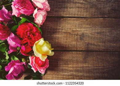 various roses on wooden surface