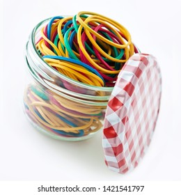 Various rubber bands and jar